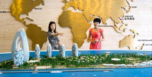 La maquette de l'île artificielle Phoenix, dont les premiers appartements seront livrés en août. À elle seule, la vente des cinq tours de logements suffira à financer la construction de tout le reste.