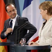 Face à Merkel, Hollande pose ses conditions