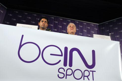 ( à gauche sur la photo), le président qatarien de BeIN Sport ...