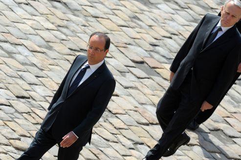 François Hollande et Jean-Marc Ayrault, le 14 juin, lors de la cérémonie d'hommage aux soldats tués en Afghanistan.
