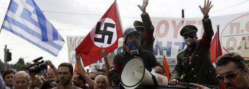 Croix gammées à Athènes: l'Allemagne sous le choc