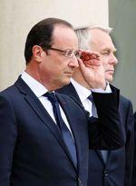 Le président de la République François Hollande et, derrière lui, le chef du gouvernement Jean-Marc Ayrault.