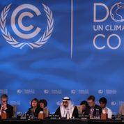 Climat: un accord arraché et contesté