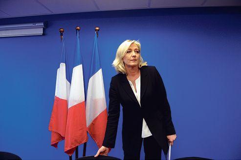Marine Le Pen lors de sa conférence de presse, vendredi, à Nanterre.