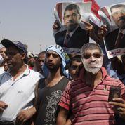 L es partisans de Morsi accusent le coup