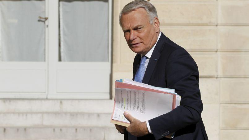Jean-Marc Ayrault, le 19 août, dans la cour de l'Élysée.
