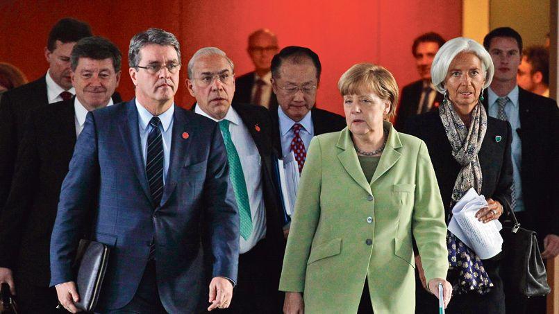 Merkel invitée à mieux répartir sa prospérité