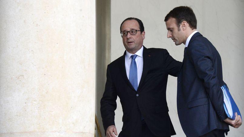 Fran�ois Hollande et le ministre de l'�conomie Emmanuel Macron