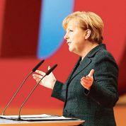 Merkel triomphe et promet de ne rien changer