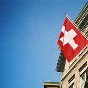 La Suisse introduit un taux d'intérêt négatif sur certains avoirs bancaires