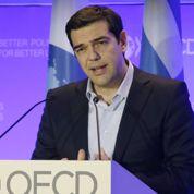À Paris, Tsipras réclame la restructuration de la dette grecque