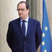 Remaniement: Hollande cherche le bon timing