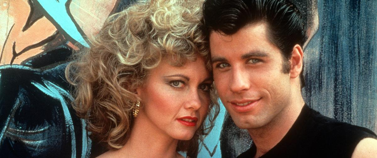 "John Travolta et Olivia Newton-John renfilent leur costume de ""Grease"", l'apparition surprise qui fait du bien"