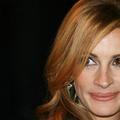 """Des boucles de """"Pretty Woman"""" au wavy signature : retour sur les coiffures de Julia Roberts"""
