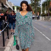 Tina Kunakey sans fard à Cannes pour sa première apparition après son accouchement