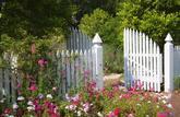 Droit de passage: un terrain sur lequel s'exerce une servitude peut être clos par un portail