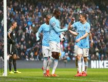 Yaya Toure (C) celebrates with Fernandinho and James Milner