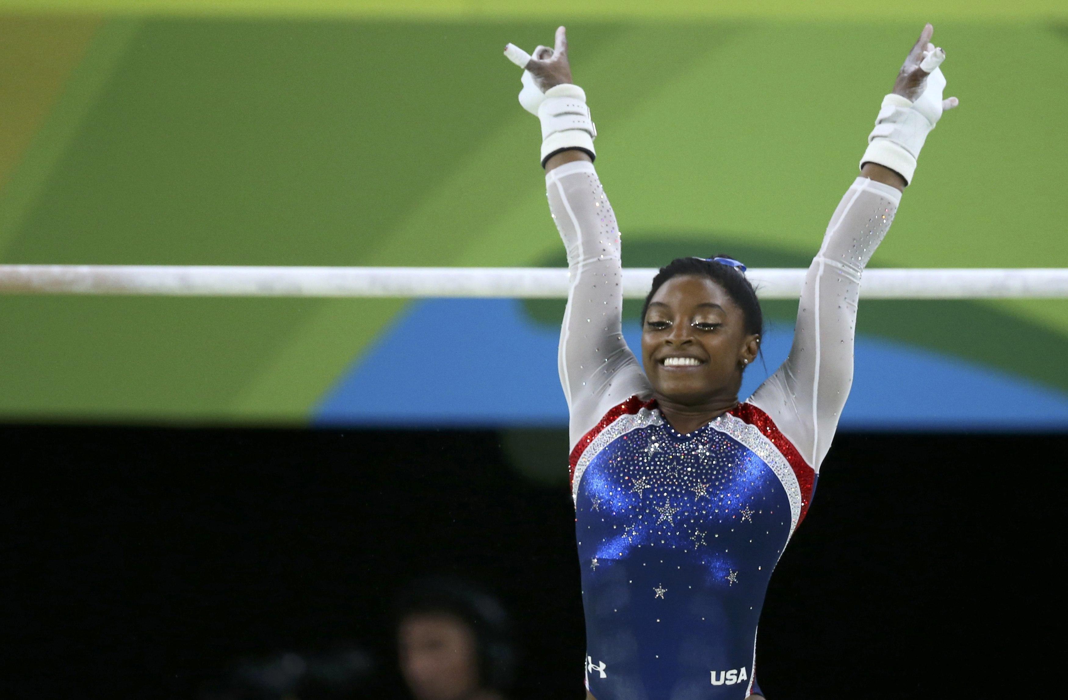 Jeux olympiques - Simone Biles entraînée par un Français