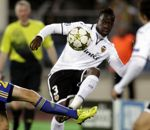BATE Borisov's Dmitri Likhtarovich fights for the ball with Valencia's Aly Cissokho during their Champions League Group F soccer match at the Dinamo...