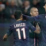 Paris St Germain's Menez celebrates with teammates Lavezzi and Ibrahimovic after he scored the third goal for the team during their Champions League...