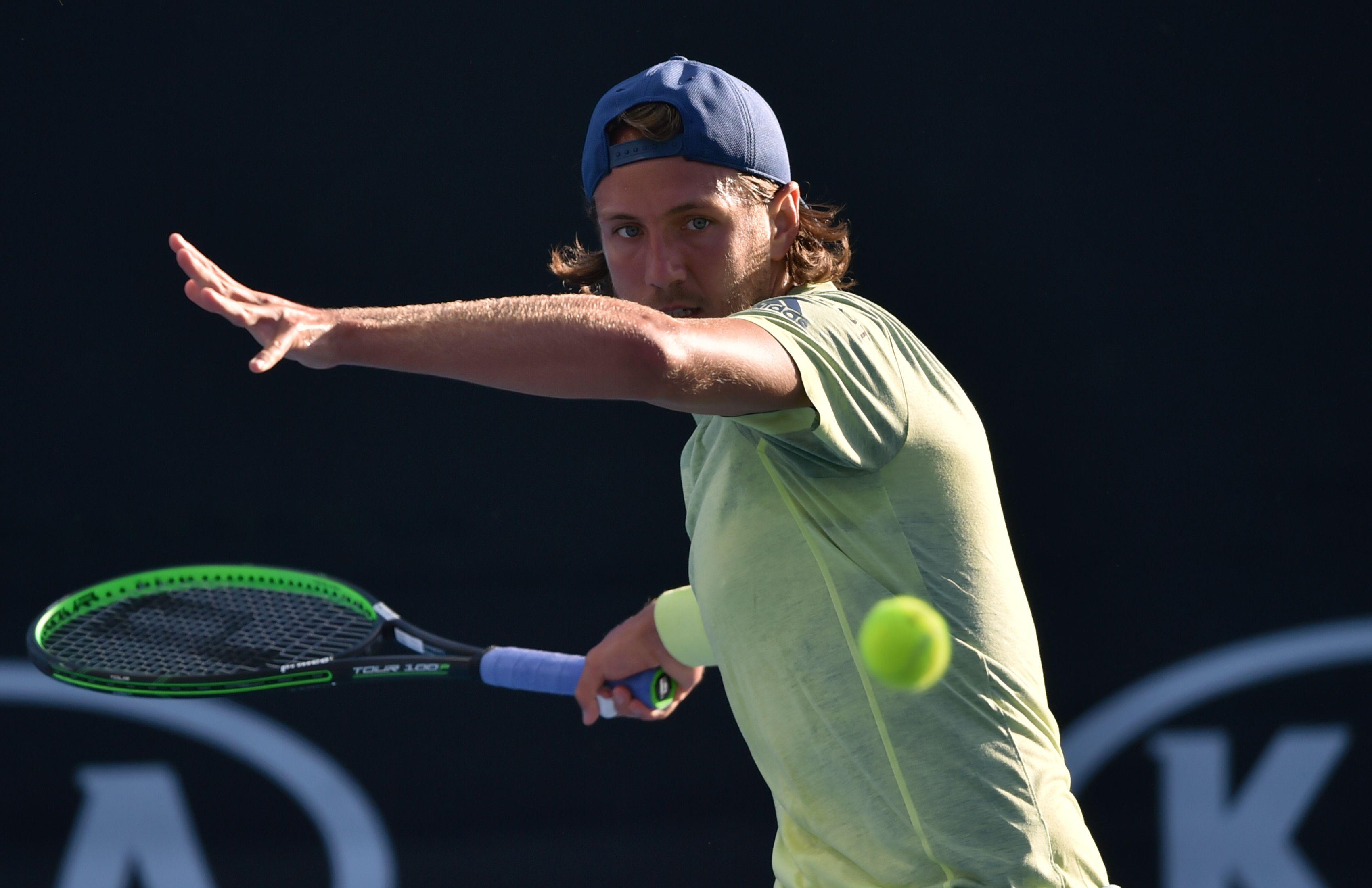 Tennis - Open Australie - Pouille soufflé d'entrée, Tsonga solide