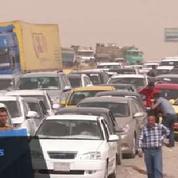 Irak : des centaines de familles quittent Mossoul