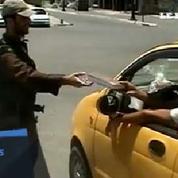 Irak : distribution de Coran dans les rues de Mossoul