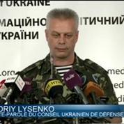 Ukraine: panique à Donetsk pendant des affrontements armés