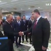 La poignée de main entre Poutine et Porochenko