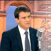 Valls rencontre les proches des victimes de Merah lors de la manifestation: un moment fort